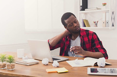 Overworked black businessman in casual office, work with laptop- Credit to https://www.lyncconf.com/ (nodstrum) Tags: work home time today hardwork working workethic homework officework cubicle workplace money jobs networking desk