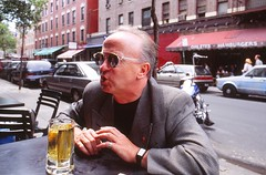 Short Beer, Little Italy (1993) (Henry Hemming) Tags: newyork film slide transparency nyc bigapple littleitaly newyorkcity man drink beer sunglasses suit reflection