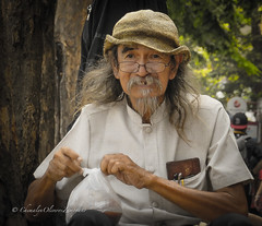 Crown of wisdom (stormymayen) Tags: old man hat hands pocket tight tree portrait teeth beard moustage longhair glasses spectacles streetphotography