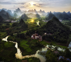 A splash of light (Dan_Fr) Tags: yangshuo guangxi cuiping china hill reflection karst landscape guilin river house goldenhour viewpoint rural village field sunset sun sunstar mountain travel sony a7r
