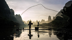 Cormorant fisherman casting net (Dan_Fr) Tags: guilin china guangxi yangshuo li river cormorant fisherman xingping karst landscape mountain hill reflection silhouette travel tradition custom dawn sunrise sky sony a7r beautiful amazing