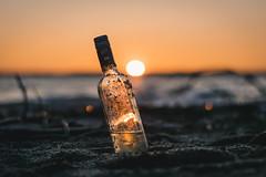Capture the Light (patviau) Tags: bottle wine beach sunset sand summer light