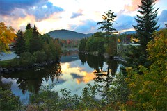 Lake Placid - New York  ~ Adirondack Mountains  ~ Historical - Sunset Reflection (Onasill ~ Bill Badzo) Tags: lakeplacid saranaclake towns nrhp essexcounty franklincounty historic tb retreat prescotthouse former hospital trudeau road bridge fall autumn collors reflections ausable river ausableriver dam newyork state staint st armand clintoncounty vacation travel hiking trekking sky clouds hdr tourist leaves turning fishing flyfishing boating town village adirondack mountains landscape seascape winter olympics canon eos rebel 18250mm macro sigma lens sl1 wood tree forest snow mountain train water atmosphere reflection sunset lake plaza mall grocery store