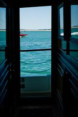 Split wake (winhide) Tags: passage event corridor mirror bostonharbour valiant tanzi group street windows boats seascape found objects corridoor boat ship sea land