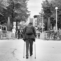 Across the bridge (andzwe) Tags: groningen man sticks crossingthebridge acrossthebridge brugover brug bridge blackandwhite street hat maninblack stokken kreupel cripple panasonicdmcgh4 alone oosterhoogebrug