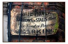 PRIVATE PROPERTY NO BARROWS OR STALLS (StockCarPete) Tags: sign londonlettering barrowsstalls market london uk balham privateproperty ghostsign oldsign yard passage message instruction