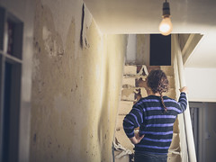 Young woman renovating a staircase - Credit to https://www.thehousewire.com/ (TheHouseWire) Tags: adult architecture background balustrade banister bulb construction contemplation debris decorating derelict design diy female floor hall handrail holding home house idea improvement indoor interior lightbulb mess messy old paint person plaster plastering renovating renovation repair room rubble stair staircase stairs stairway standing thought wall wallpaper white woman wood wooden work young