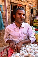 Bakhtapur, Nepal (dderici) Tags: canon7d tamron 1750 bakhtapur nepal nepali portrait travel garlic marketplace seller