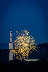 Explosions paint the sky around the Saturn V rocket. (Jens Lambert Photography) Tags: alabama celebration davidsonspaceandrocketcenter entertainment fireworks huntsville july4th nightsky rocket saturnv space tranquilitybay colorful explosion stock