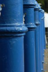 blue bollards (FanDabbyDavey) Tags: bollard blue line row perspective blur upright distance d3100
