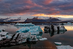 Floating Art (pdxsafariguy) Tags: jokulsarlon glacier lagoon iceland iceberg reflection sunset mountain snow clouds ice water glacial nature landscape blue arctic europe vatnajokull tranquil landmark tomschwabel