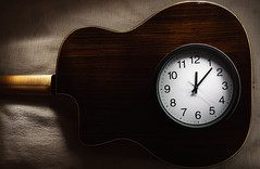 It is Time for Music (dejankrsmanovic) Tags: clock watch time hour minute precise accurate circle blanket sheet cloth clothe fabric concept conceptual object stilllife structure number classical vintage retro twelve acoustic guitar musical instrument gypsy swing round copyspace closeup brown white afternoon beige wooden wood