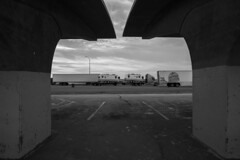 Airstreams (JasonCameron) Tags: west desert utah rest stop truck black white bw monochrome sunset sundown dusk clouds frame air stream transport