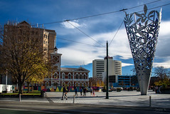 Cathedral Square (Jocey K) Tags: cathedralsquare newzealand nikond750 christchurch cbd city architecture buildings trees shadows sky clouds mural streetart artwork sculpture