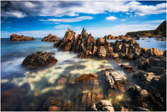 Moment of Activity (Augmented Reality Images (Getty Contributor)) Tags: nisifilters aberdeenshire benro bluesky canon clouds cullen headland horizon landscape longexposure rocks scotland seascape summer water waves