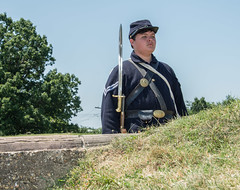 A Reenactor Stands Guard at the Wall of Fort Stevens (scattered1) Tags: 139th 154thanniversary 61st american battleoffortstevens civilwar companyf dc districtofcolumbia fortstevens nationalparkservice pvi pennsylvaniavolunteerinfantry usarmy union war washington zouaverifle anniversary army bayonet blue breastplate civil commemoration historic history man reenactor rifle slingplate soldier uniform weapon unitedstates us