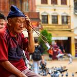 Man holding prayer beads at Boudhanath Stupa in Kathmandu, Nepal thumbnail