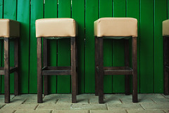 Empty Bar Chairs (dejankrsmanovic) Tags: empty seat chair bar cafe restaurant outdoors lifestyle green furniture day object stilllife nobody restful detail background concept conceptual structure wood wooden frame fence painted color abstract group row column order service plank floor