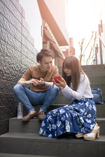 Young couple looking at screen on smart phone together