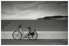 The bike (GP Camera) Tags: nikond80 nikonafsdx1855mmf3556gvr bike bicicletta wall muro seafront lungomare stair scala hill collina city città sky cielo lines linee summer estate lightandshadows lucieombre shades sfumature vignetting silence silenzio calm calma quiet quiete details dettagli horizon orizzonte evening sera bw biancoenero monochrome monocromo whiteframe cornicebianca italy italia marche darktable gimp opensource freesoftware softwarelibero digitalprocessing elaborazionedigitale