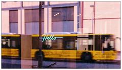 Hello (Silke Klimesch) Tags: 7dwf crazytuesday ctt signspostersoradvertisments berlin kreuzberg sign neon hello bus yellow reflections window street motionblur motion traffic flickrfriends panasoniclumixdmclx100 lumixlx100 lumix leica leicadcvariosummilux mft compactcamera nik viveza colorefex thewho 515 quadrophenia insideoutside