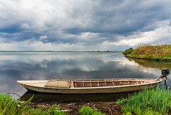 Kotychi Wetland.. (ckollias) Tags: wetland beautyinnature cloudsky day idyllic kotychi lake modeoftransportation moored nature nauticalvessel nopeople nonurbanscene outdoors plant rowboat scenicsnature sky tranquilscene tranquility transportation water