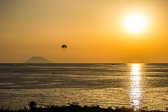 Heat (view full-screen) (Piotr_PopUp) Tags: tropea calabria italy mezzogiorno stromboli tyrrheniansea mediterranean eolie aeolianislands parasailing volcano volcan sea water sunset sun afternoon heat heatwave summer travel yellow gold italia contrast minimal minimalistic light