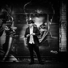 Lightbulb moment (Kieron Ellis) Tags: man street hat suit streetart graffiti blackandwhite blackwhite monochrome candid padlock