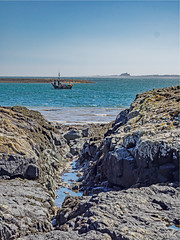 View Across to Bamburgh #2 (Novocastria Photography) Tags: lindisfarne holyisland sea seaside coast rock rocks sand tide outgoingtide vintagephotograph newcastlechronicle northernecho boat bamburgh bamburghcastle