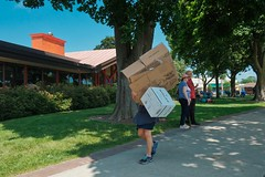 (Plane Sight Images) Tags: cardboardboxes load trash sidewalk boxes outdoors woman color streetphotography