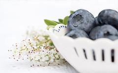 blueberries for macro mondays 'snack' (Emma Varley) Tags: blueberries fruit stilllife china bowl miniature blue white highkey macro mondays refreshments