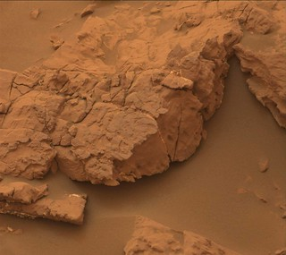 Red Rock on Brown Sand in a Dust Storm