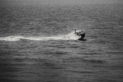 Wave Hopper - 176295 (SNAPShots by Patrick J. Whitfield) Tags: boats fishing fishingboats water waves ocean sea seaside wet movement lines patterns texture detail dof action life old bw bnw noiretblanc blackwhite blackandwhite monochrome outside vessels ship rural reflections bay sunshine harbour countryside
