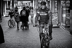 Riding In The Name Of The Law (Alfred Grupstra) Tags: bicycle cycling people street men citylife urbanscene city outdoors lifestyles modeoftransport cycle transportation editorial cyclist netherlands leisureactivity sport commuter travel police
