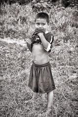A tasty t-shirt (Pejasar) Tags: honduras grass blackandwhite bw child boy