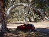 Tempting Fate (mikecogh) Tags: arch branch bough gumtree curved under car mazda parked contrast shade mountremarkable