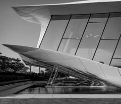 Etihad museum, Dubai, UAE (Gadjowsky) Tags: nikon d5100 dubai uae blackandwhite architecture detail ambient atmoshpere design museum contrast travel geometry curves water reflection
