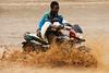 good idea? (rick.onorato) Tags: africa ethiopia omo valley tribes tribal boy motorbike river