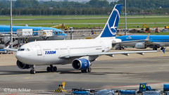 "Tarom YR-LCB A310 which is 26.3 years old seen here at Amsterdam taxing to take-off, this airframe and its sistership YR-LCA have been transferred to a new Armenian start-up ""Armenia Airways"". 6.9.15 (Yazn Achtar) Tags: subhanallah beautiful beautifulshot beauty photographyatitsbest planespotter planespotting photography photooftheday planes photograhyatitsbest amsterdam amsterdamschiphol tarom a310 bucharest romania nikonphotography beautifulsky beautifulphoto beautifullivery beautifullight beautifulaircraft beautifulbackground beauituflsunrise beaconshot ams amesterdamschiphol salam"