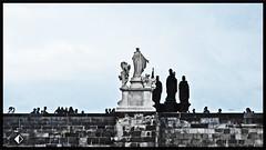 saints in stone (t.horak) Tags: saints stone black blue prague praha czech bohemia charlesiv capital bridge charles karel karluv most people