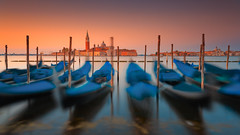 The dancing gondolas of Venice (Bernhard Sitzwohl) Tags: venice italy travel sangiorgio island travelphotography cityscape dawn morning sunrise red softlight pastel sonnenaufgang c