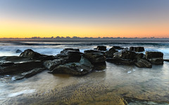 Rocky Seascape (Merrillie) Tags: forrestersbeach sand nature dawn tessellate surf wamberal newsouthwales sea morning beach ocean tesssellation coastal outdoors daybreak landscape australia weather waves earlymorning sunrise rocky tessellated rocks water blueskies centralcoast nsw seascape sky coast waterscape seaside