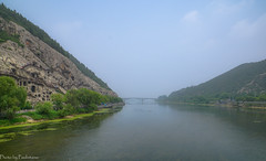 Yihe river / Река Ихэ (Vladimir Zhdanov) Tags: china travel sky ancient landscape river yihe longmen cloud bridge tree mist