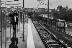 On the platform / rain is what you need (Özgür Gürgey) Tags: 2018 bw d750 kazlıçeşme nikon lines people platform rails rain reflection repetition street istanbul