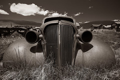 Just Another Head Shot (CameraOne) Tags: headshot oldcar relic ruins ghosttown classiccar urbandecay bodie statepark wideangle raw sepia monochrome blackandwhite canon6d canonef1740mm polarizer clouds closeup frontal rust rustycar owensvalley california cameraone historic museum