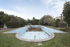 Villa del Mare (Sean M Richardson) Tags: abandoned villa exterior swimming pool canon decay naturetakesover green blue white statue sky ruins textures symmetry