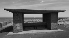 shelter (Mr Ian Lamb 2) Tags: coastal shelter monochrome bandw brick concrete seat bench abstract austere architecture sea ship boat plain simple basic
