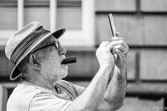 Selfie (Cycling Road Hog 2018) Tags: beard blackwhite candid canoneos750d citylife colour efs55250mmf456isstm edinburgh fashion hat man mobile monochrome people phone places royalmile scotland smoke smoking street streetphotography streetportrait style urban