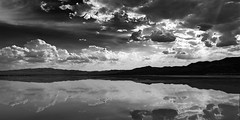 024693763524-102-Not so Dry El Dorado Dry Lake Bed-4-Black and White (Jim There's things half in shadow and in light) Tags: 2018 america canon5dmarkiv eldoradocanyon july miningtown mojave nelson nevada nevadacameraclubfieldtrip southwest tamron2470mmf28divcusdg2 usa clouds cloudy desert ghosttown stormy summer drylakebed landscape blackandwhite water reflections earth sky