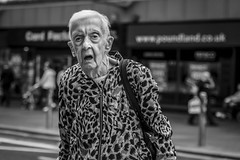 Spotted (Leanne Boulton) Tags: portrait urban street candid portraiture streetphotography candidstreetphotography candidportrait streetportrait eyecontact candideyecontact streetlife old elderly woman female face eyes mouth expression mood emotion feeling atmosphere pattern style tone texture detail depthoffield bokeh naturallight outdoor light shade city scene human life living humanity society culture lifestyle people canon canon5dmkiii 70mm ef2470mmf28liiusm black white blackwhite bw mono blackandwhite monochrome glasgow scotland uk